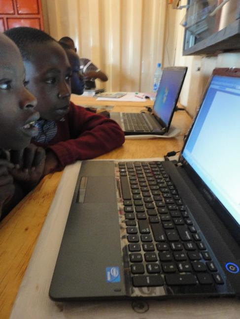 Students at Ngeya School seeing their first computers.